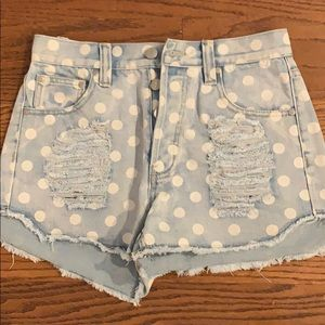 Mink pink polka dot distressed denim shorts